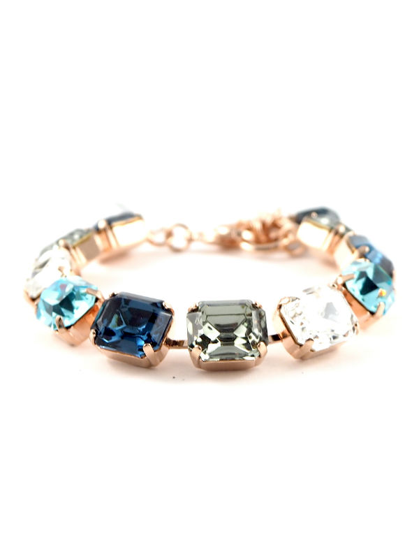 Mystique Nightfall bracelets are layered in 18-carat Rose Gold or Rhodium (silver) featuring Swarovski Crystals: Aquamarine, Black Diamond, Indicolite, Multicolour Czech Crystal, Montana Blue, Light Turquoise and Clear.