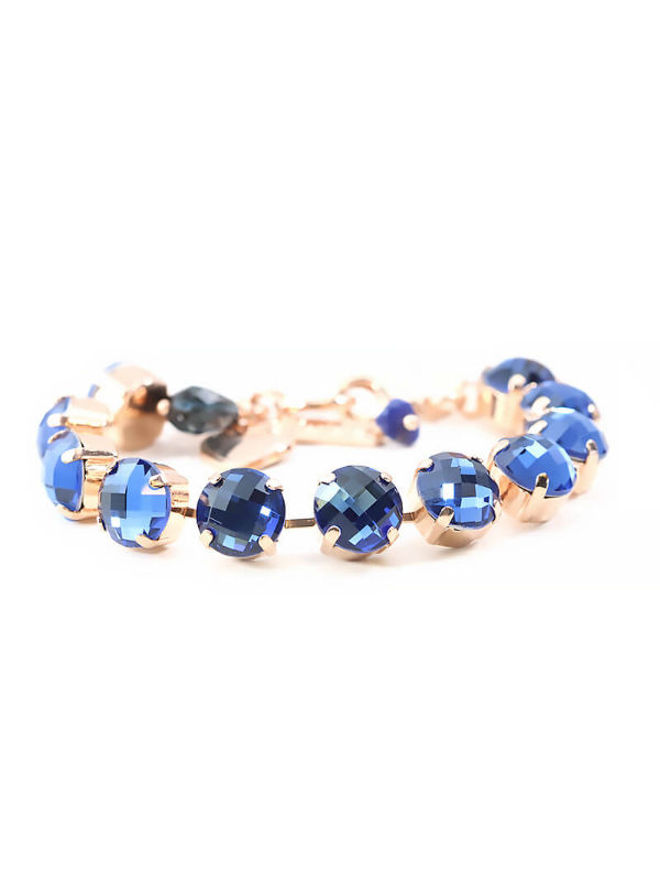 Mystique Nightfall Bracelets are layered in 18-carat Rose Gold featuring Swarovski Crystals: Aquamarine, Black Diamond, Indicolite, Multicolour Czech Crystal, Montana Blue, Light Turquoise and Clear.