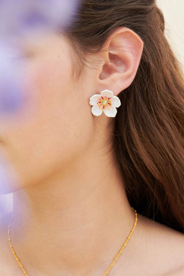 Gold-plated brass, cherry blossoms, white porcelain enamel, daffodil cut crystal crowned with golden pistils.