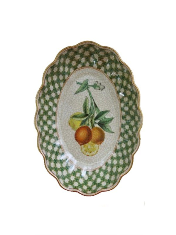 A very glamorous dish, oval in shape trimmed with a scalloped, green checkered edge and gold trim. Citrus themed artwork in lemon and orange colours with green foliage. Typical of Creatively Active Minds, the procelain has a crackled finished to give the impression of age. Measures 20 x 14 x 4cm