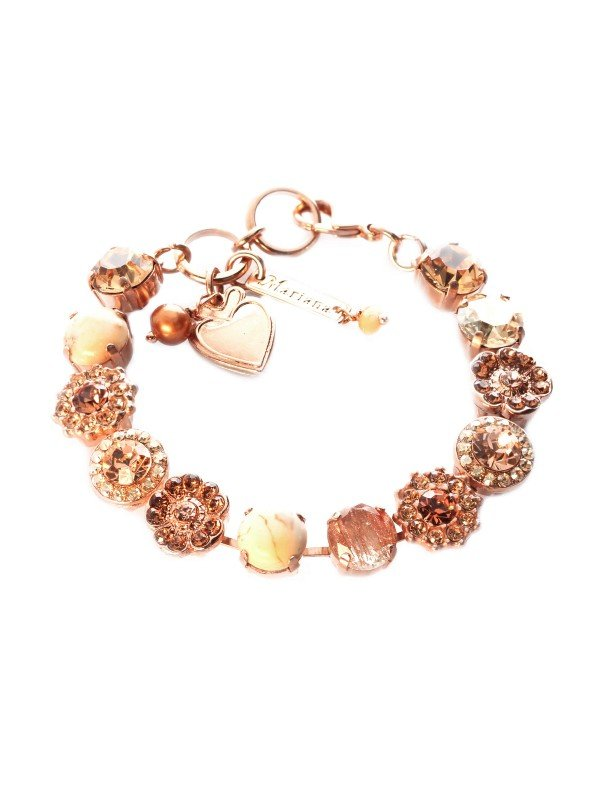 Earthy colours of browns and rust meld with the richness of amber coloured Swarovski crystals. Highlights are the faux cream coloured stones in a rose gold plated metal. 18cm with parrot clasp. Mariana's Winter 2021 Out of Africa Collection
