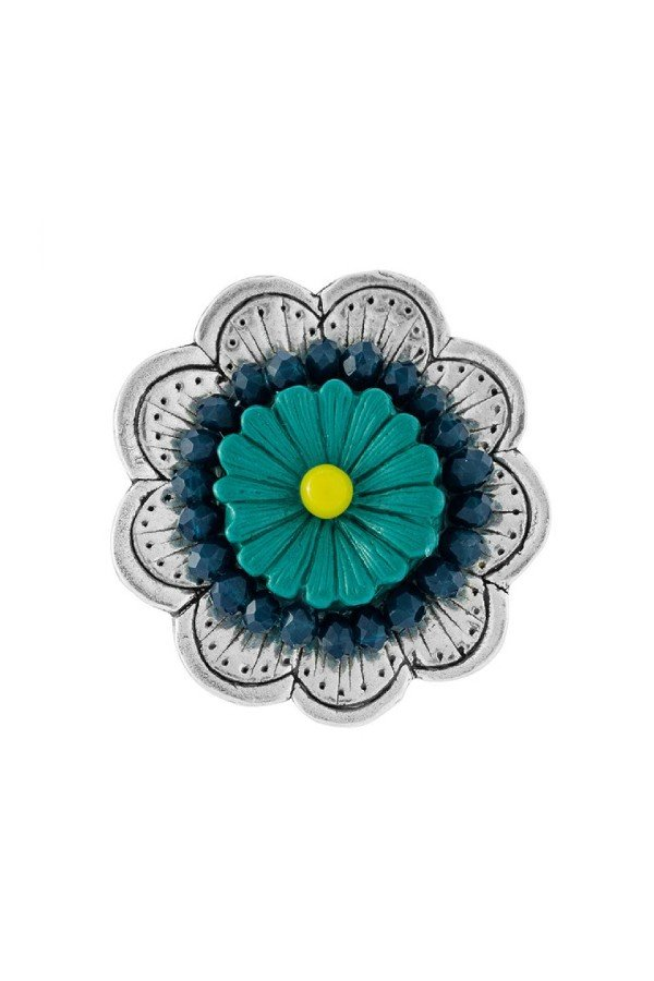 Adjustable Ring from Taratata;s Jealousy Collection. Silver metal petals with centrepiece teal beads and yellow stamen.