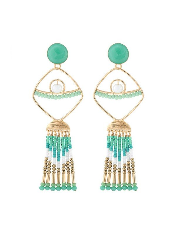 The Poseidon Collection from Taratata Bijoux is distinguished by its gold coloured metal formed in the silhouette of a fish trimmed with turquoise and gold coloured glass beads to form the tail.Long statement earrings measuring 9.2cm. Stud setting