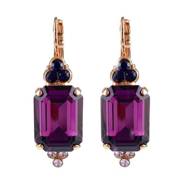 Eye-catching port wine, large rectangular crystal forms the centrepiece of this setting. A small triangle encrusted with violet crystals on top and an inverted triangle encrusted with mauve crystals on the bottom. Mariana, the designer, has set these on a French hook with rose gold plating.