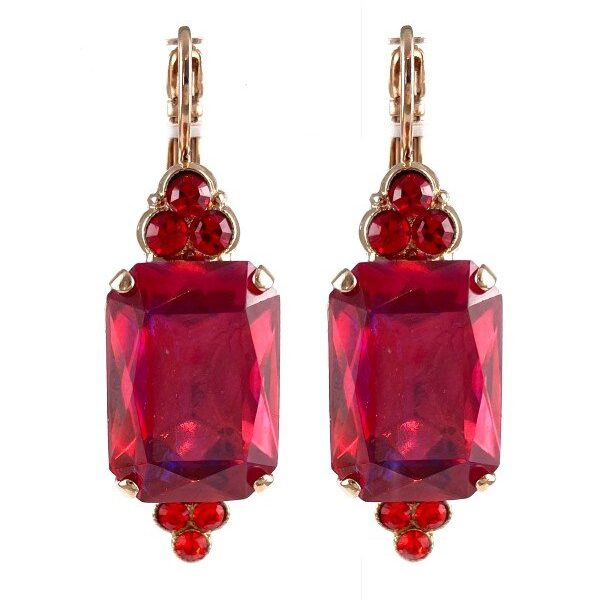 Eye-catching crimson, large rectangular crystal forms the centrepiece of this setting. A small triangle encrusted with ruby red crystals on top and in an inverted triangle on the bottom. Mariana, the designer, has set these on a French hook with rose gold plating.