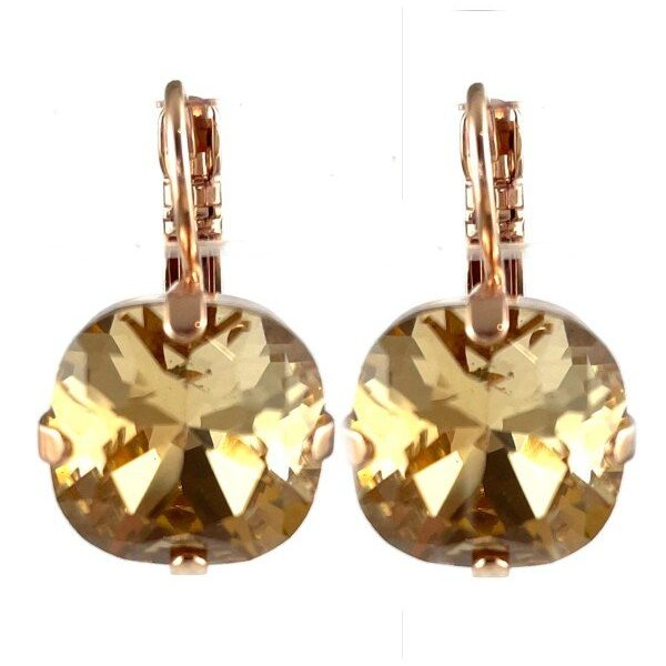 Earrings designed as a simple yet classical setting featuring a pale gold square cut crystal. French hooks and rose gold plated metal.