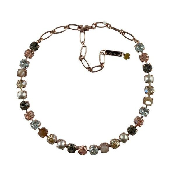 Mariana captivates with the use of white faux pearls combined with ice blue, pale peach, amber and earthy rust tones in her Moonlight & Magnolias Collection.