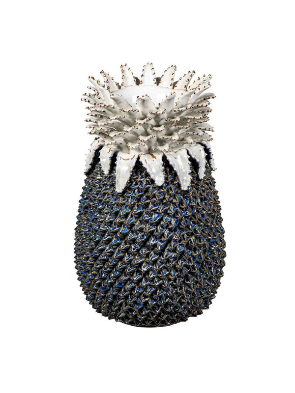 A stunning ceramic Pineapple Vase with a glazed navy base and white leaves. This statement piece would effortlessly suit Hamptons style decor or would sit beautifully as a statement piece in any living room. Composition: Glazed ceramic Measurements: L 36cm, W 36cm, H 46cm