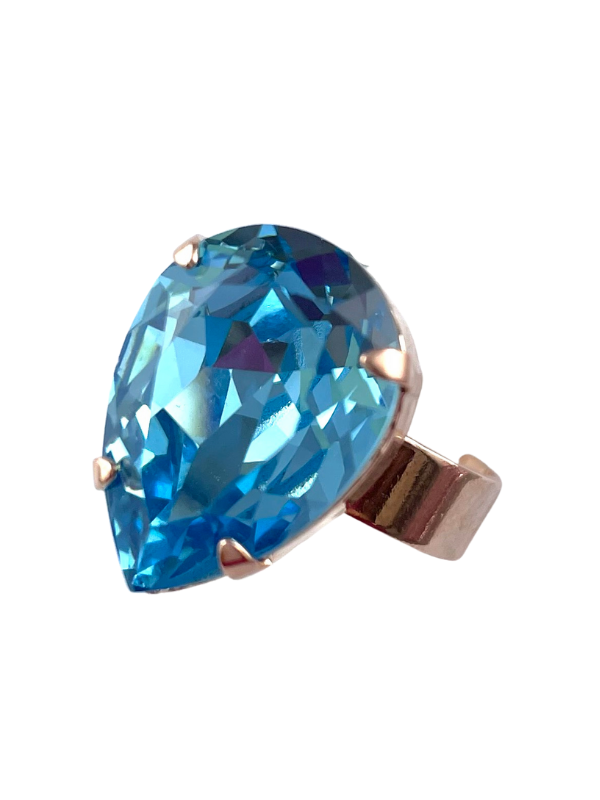 Dress ring with stunning teardrop shaped crystal in soft sky blue. Set on a rose gold adjustable band.