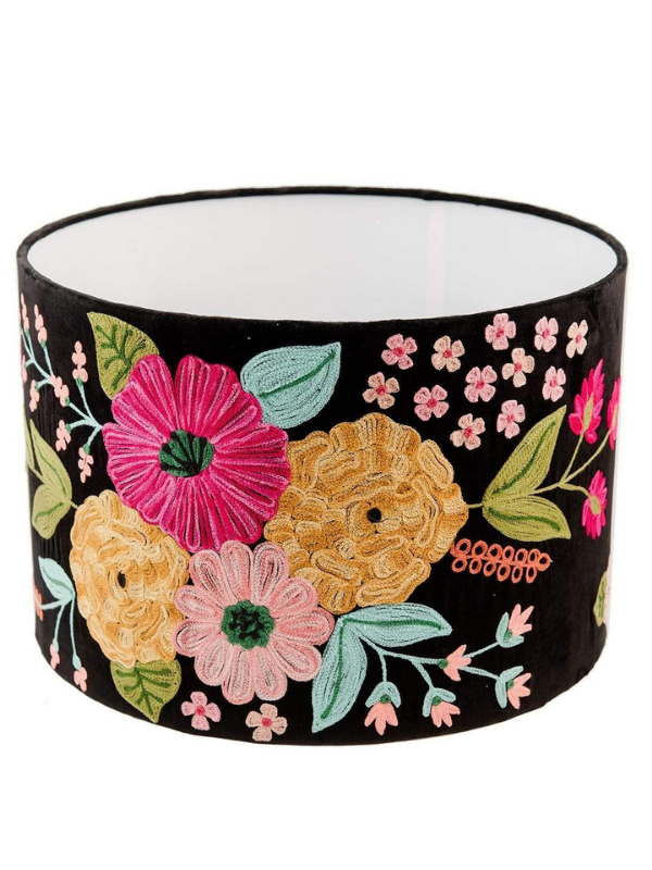 A statement, decorative lamp shade embroidered over black velvet. Multi coloured floral pattern shade that may be used as a pendant or shade for a table lamp base. Composition: Lined, embroidered velvet lamp shade over a metal frame. Measurements: Diam 46.5cm x H 31cm