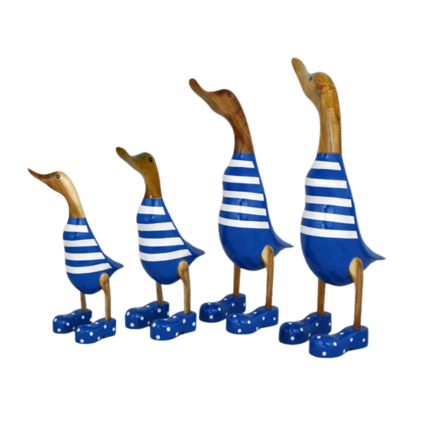 Comical ducks in in a stripey blue and white outfit wearing blue boots. Hand carved from timber.