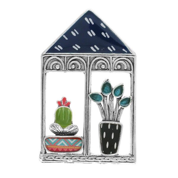 The Winter Garden Collection from Taratata Bijoux intrigues with cactus and multi-coloured, decorated potted plant motifs overlaid on silver coloured metal. This brooch features a squat cactus in a patterned bowl and a taller plant in a tall pot, all housed in a greenhouse frame.