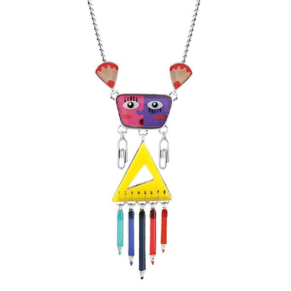 Typical of French Brand, Taratata Bijoux' designs, this jewellery collection features a character that has been formed using a yellow triangle ruler for the body with multi-coloured pencils dangling below, a purple and pink face wearing paperclip earrings. This is a definite conversation starter!