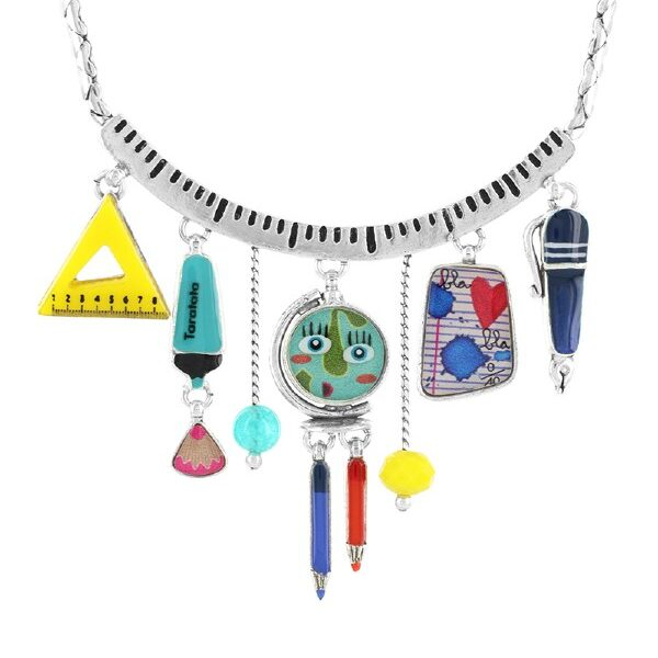 Quirky, comical Geography History collection from French designer, Taratata Bijoux. A 43cm necklace with 7 pendants hanging from the collar - a triangular measure, highlighting pen, world globe with comic face, ink pen and pencils. Multi coloured on silver metal.