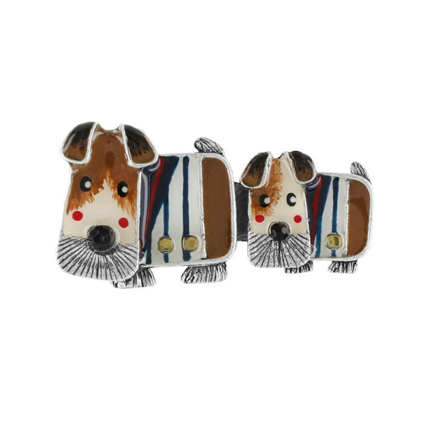 The cutest, little French terrier, Lucien, is Taratata's canine collection for the season. Designed with a brown and white faced dog with floppy ears wearing a navy and white stripe buttoned shirt and navy scarf. Fall in love.
