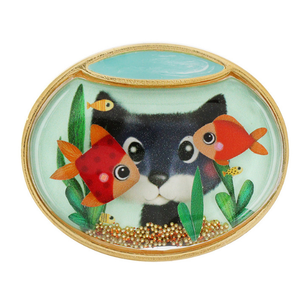 Taratata's Crush jewellery collection is designed with a black cat looking into an aqua coloured fish bowl with red fish and green grasses as its centrepiece. Gold coloured metal.