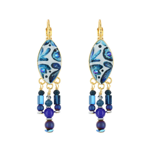 Fresh and eye-catching - ideal resort wear jewellery from Taratata Bijoux. Collection is named Five O'Clock and features cobalt, vibrant blue floral artwork over a white background co-ordinated with gold coloured metal. These 2cm long earrings are set on a French hook with a eye shape pattern motif.