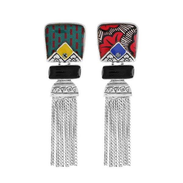 The Wax Collection from Taratata Bijoux features jewellery that combines bold, primary colours of yellow, red, blue and green with stunning geometric patterns. The Collection is set in silver coloured metal and is designed in France.