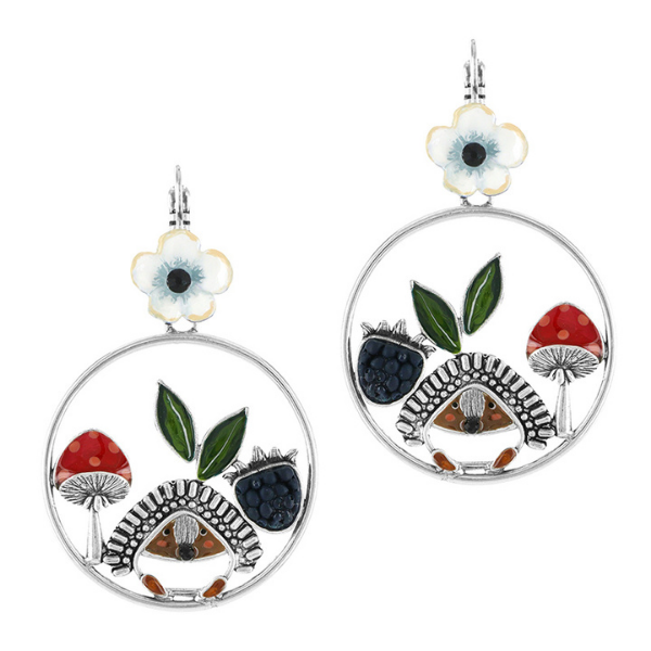 A prickly porcupine, red spot topped mushroom , purple berry and delicate white flower form the design in Taratata's Fruits des Bois jewellery collection. Design in France, Forest Fruits Collection is set in silver coloured metal.