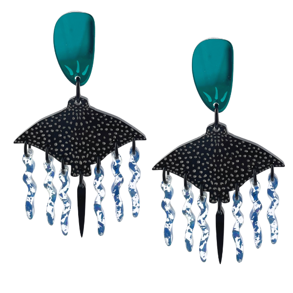 The designer's incredible interpretation of the Eagle Ray is featured in these Australian Made earrings. Handrafted using perspex, the body of the Eagle Ray is black with white dots and has clear/ blue glitter as tentacles.