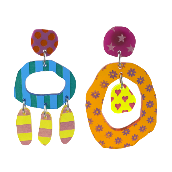 These earrings are a 70s special - hip, funky asymmetric. Multi coloured, multi patterns of stripes, dots, flowers, hearts and stars, these are the perfect earrings for the non-conformist! Made in Australia from perspex, 7.5cm long with a stud setting.