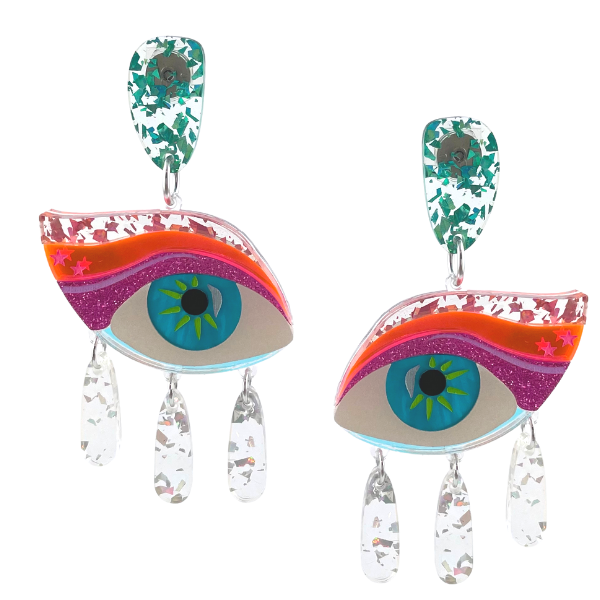"""Not for the feint hearted, these Dame Edna inspired """"Eye Candy"""" earrings will attract attention. Piecing blue iris with hot pink eyeshadow. Clear glitter infused dangles under the eyes enhance the design. Measuring 8.5cm of lightweight perspex. Australian made. Stud setting."""
