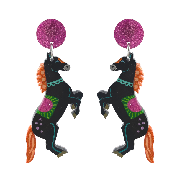 Black Beauty. These black pony earrings have been designed with a pink glitter saddle and orange tail and mane. Handmade in Australia using lightweight perspex.